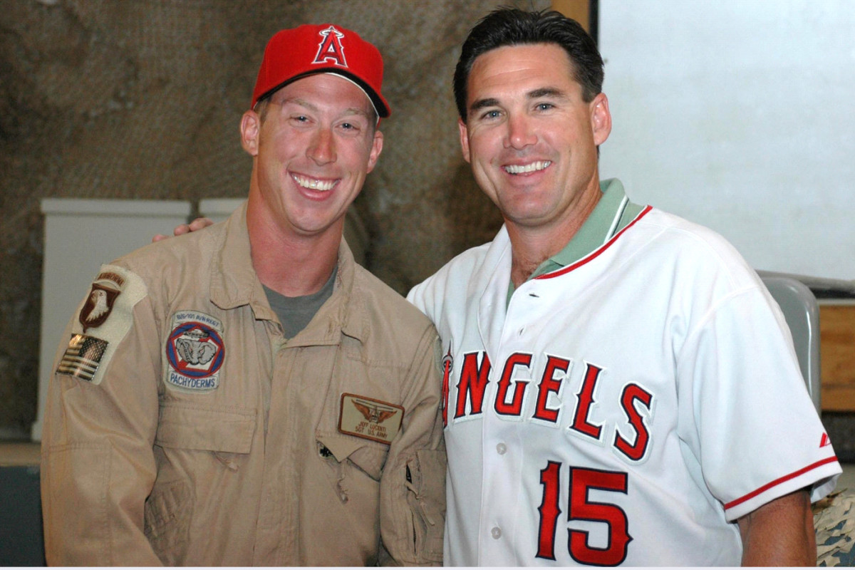 """Tim Salmon (right) visits with troops overseas. The """"Kingfish"""" was one of the most popular players in franchise history."""