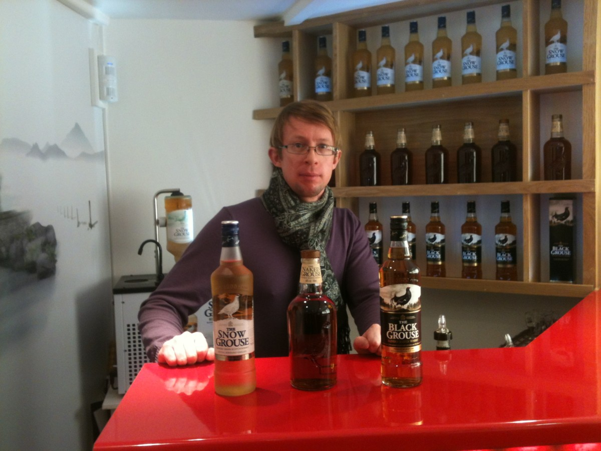 Sat behind the tasting bar at Glenturret after a day on the ski slopes at Glenshee