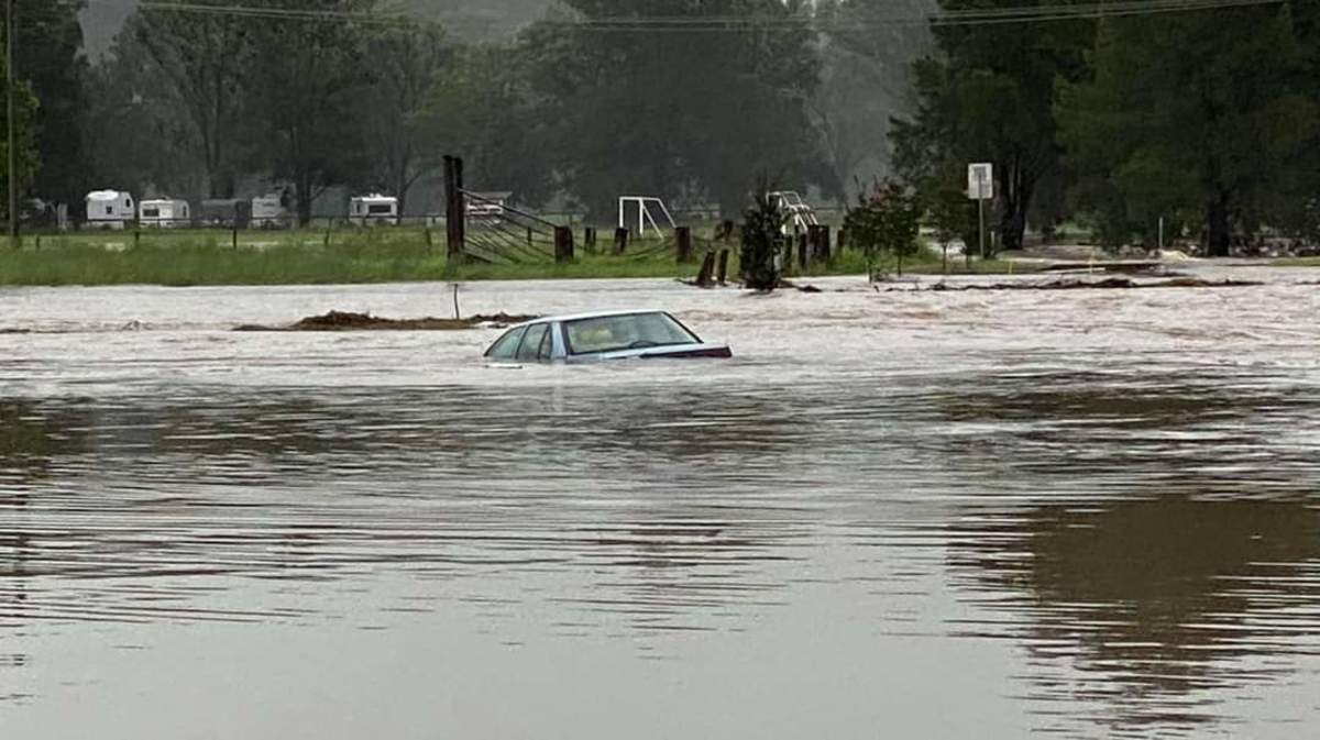 A car under flood waters at Gloucester
