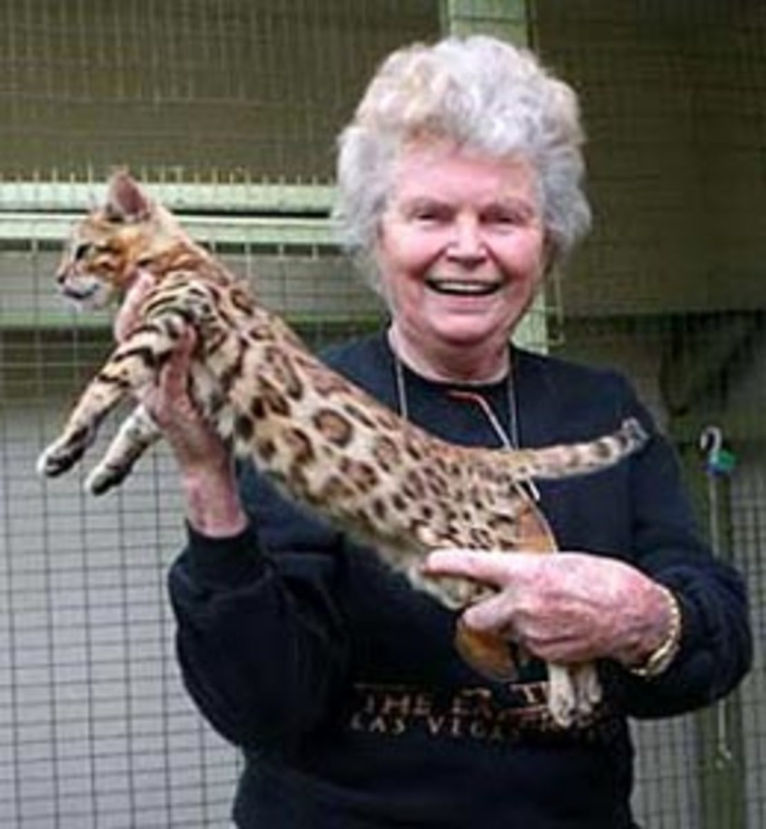 Jean Sugden Mill holding a Bengal cat in an undated photo.