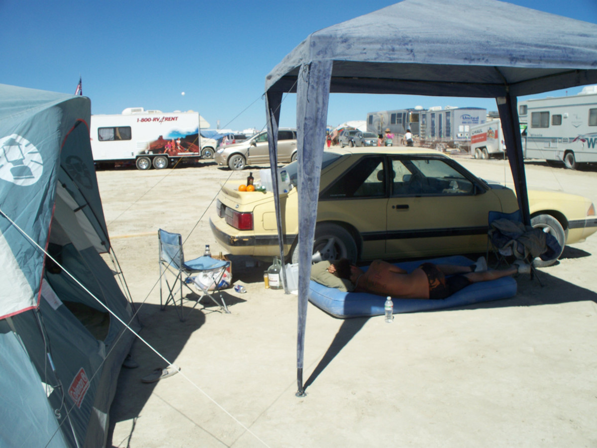 Feel free to go without a tent, but at least bring a good shade structure. Then add some shade cloth or tarps to keep the sun from coming in the sides.