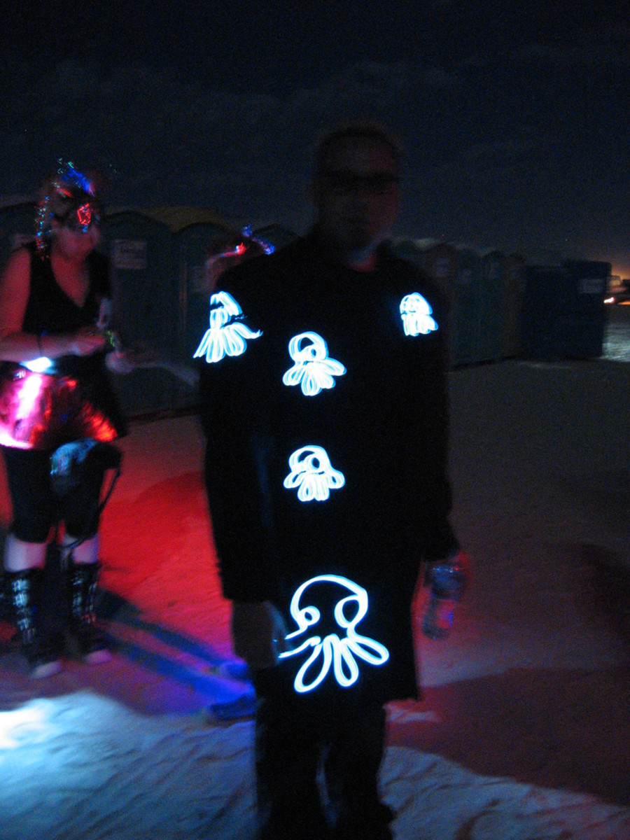 A cephalopod coat featuring cute octopi el wire creatures.