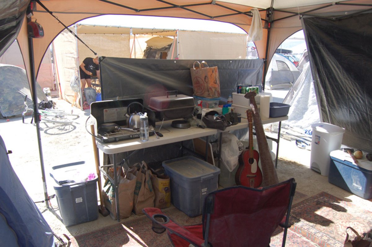 A well set up camp kitchen makes the entire week easier. Keeping at least some of the dust out is important.