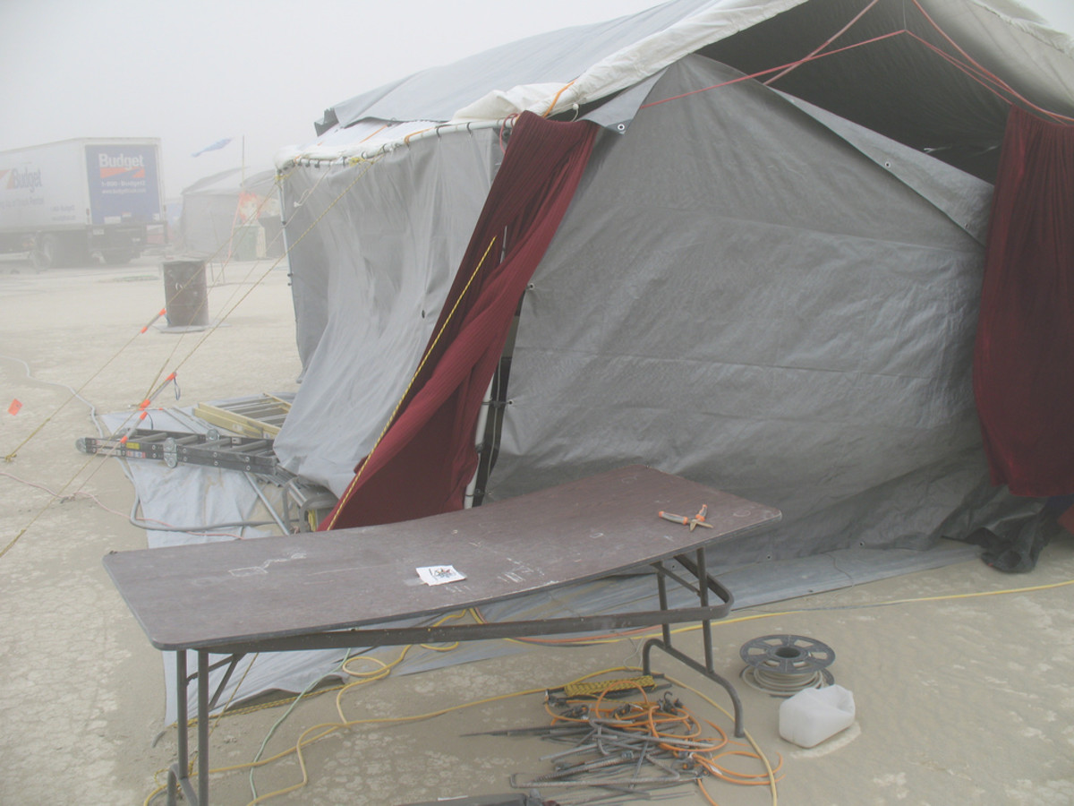 The wind in the Black Rock Desert can rip apart anything. Looks like this camp was hit before they could completely secure themselves. Get set up quickly to avoid damage.