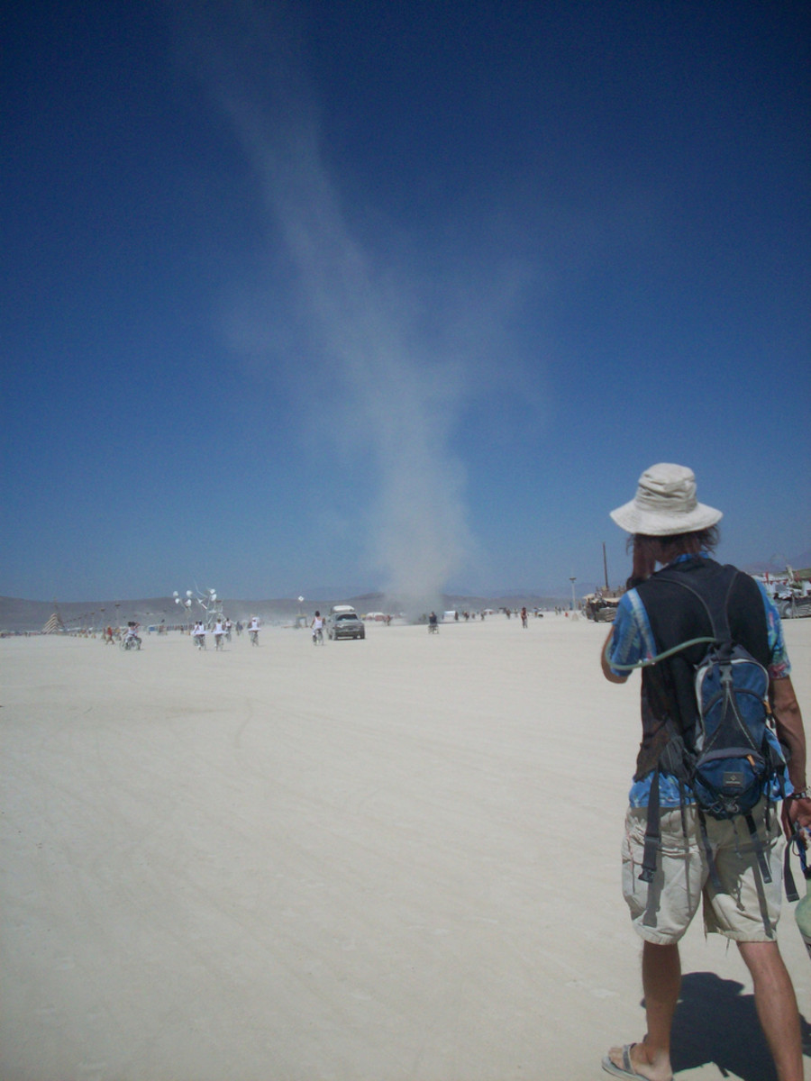 A smart Burner should never be without a good sunhat, sunglasses, and his hydration backpack. In that pack he also has goggles and a dust mask in case that dust devil turns into a dust storm.