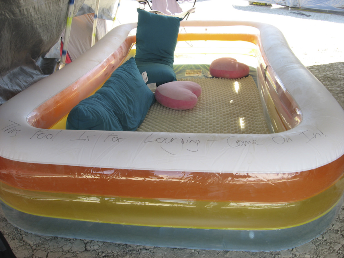 An inflatable pool filled with cushions and pillows makes for a lovely place to laze.