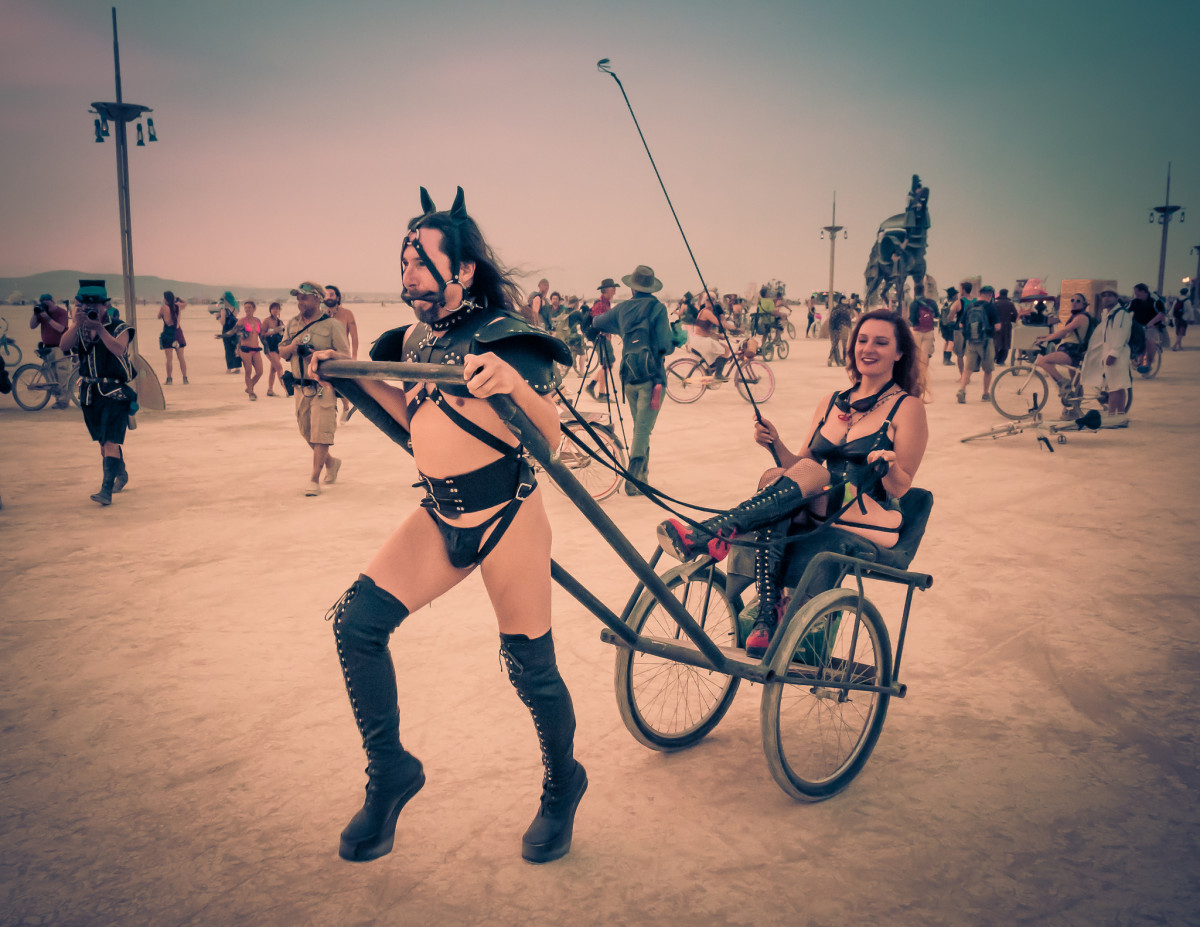 Pony play couple playing around on the playa.