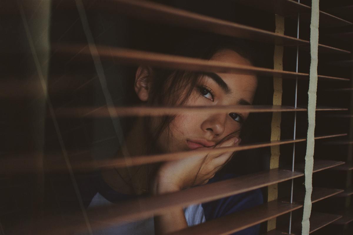 Sad Woman by the Window