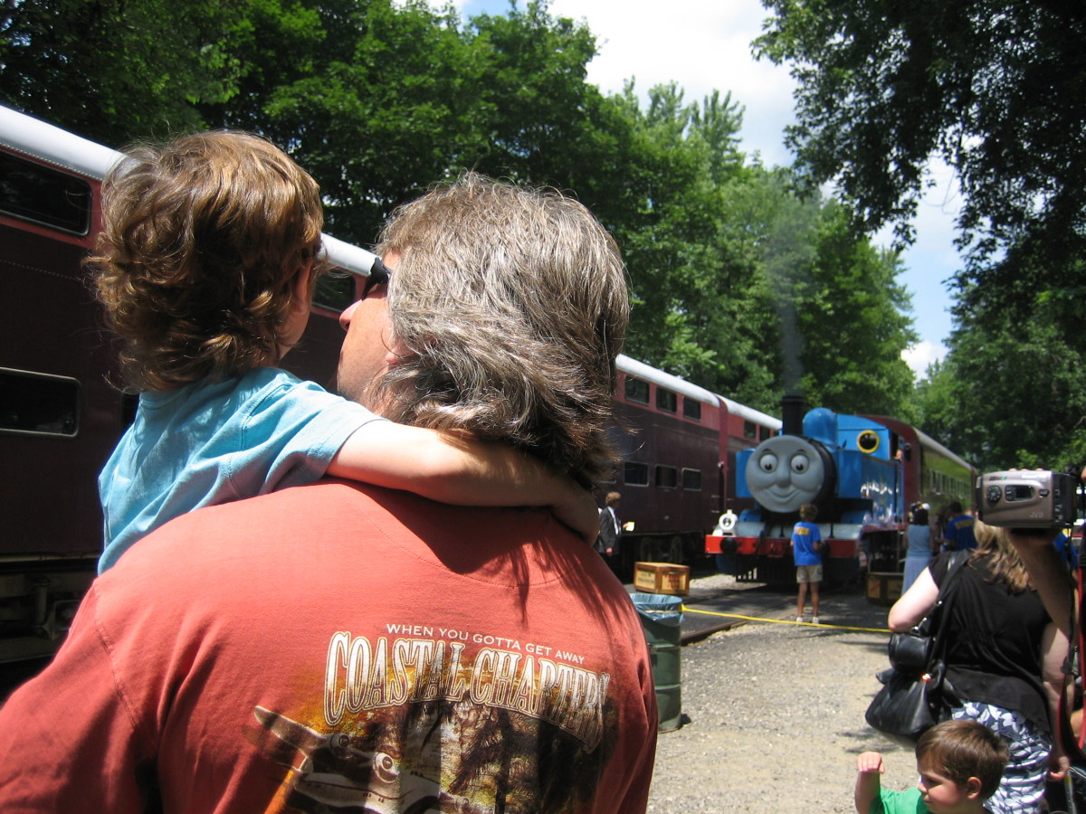 My son and his daddy checking out the Thomas the Tank Engine train