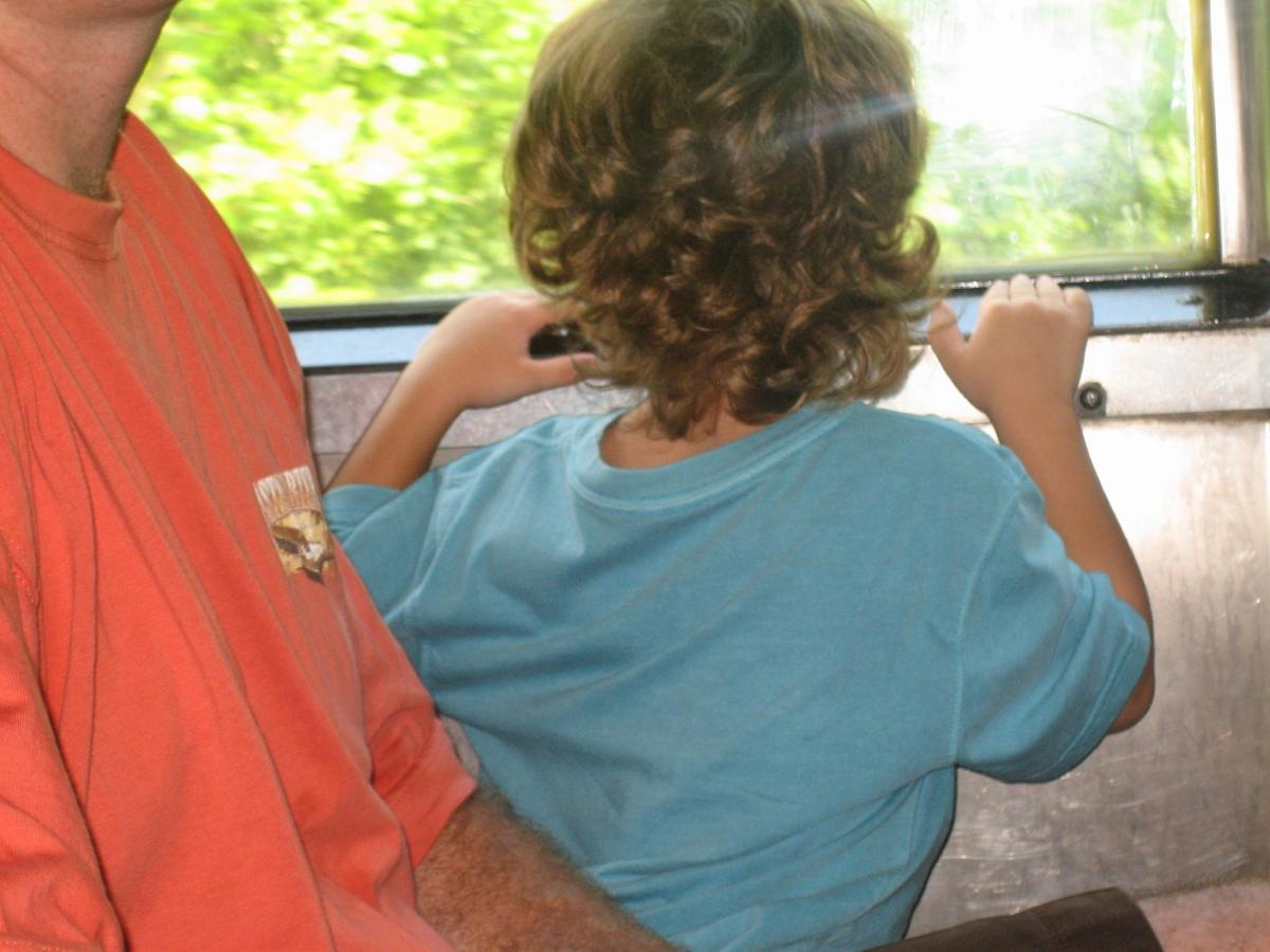 My son looking out the window during the train ride on Thomas