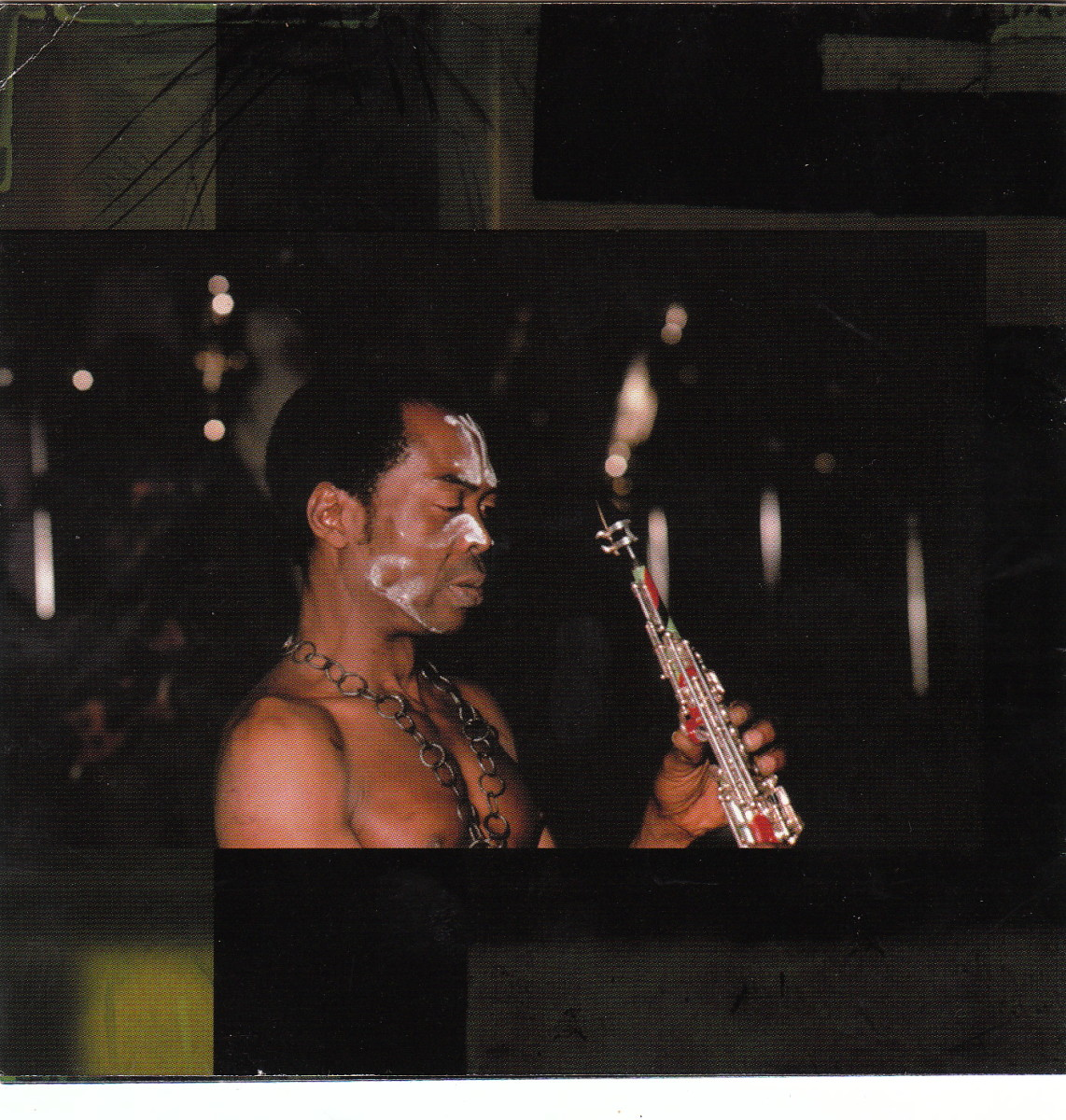 Fela Kuti in performance about to play his sax