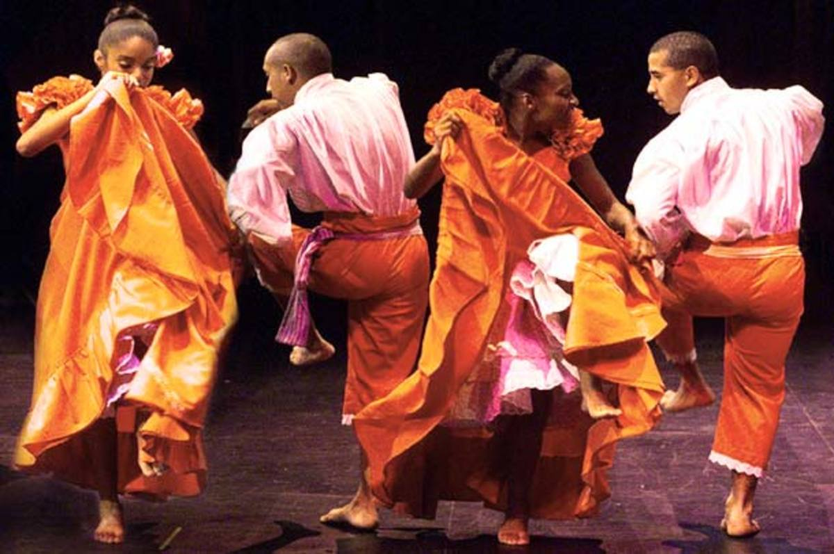 """Festejo Ritmo dancers bare-footed, jumping foot to foot, shake shoulders and spin, dance separately with energetic exuberance. This is a dance performed by Africans in Peru"