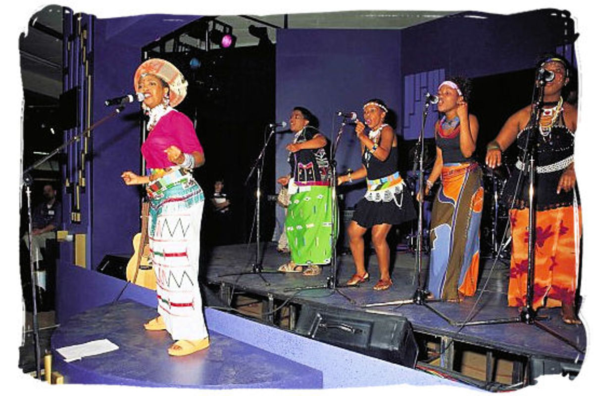 a Capella and traditional songs. south African Music, is now a Fusion of South African Music cultures as can be seen in the mixed traditonal garb.