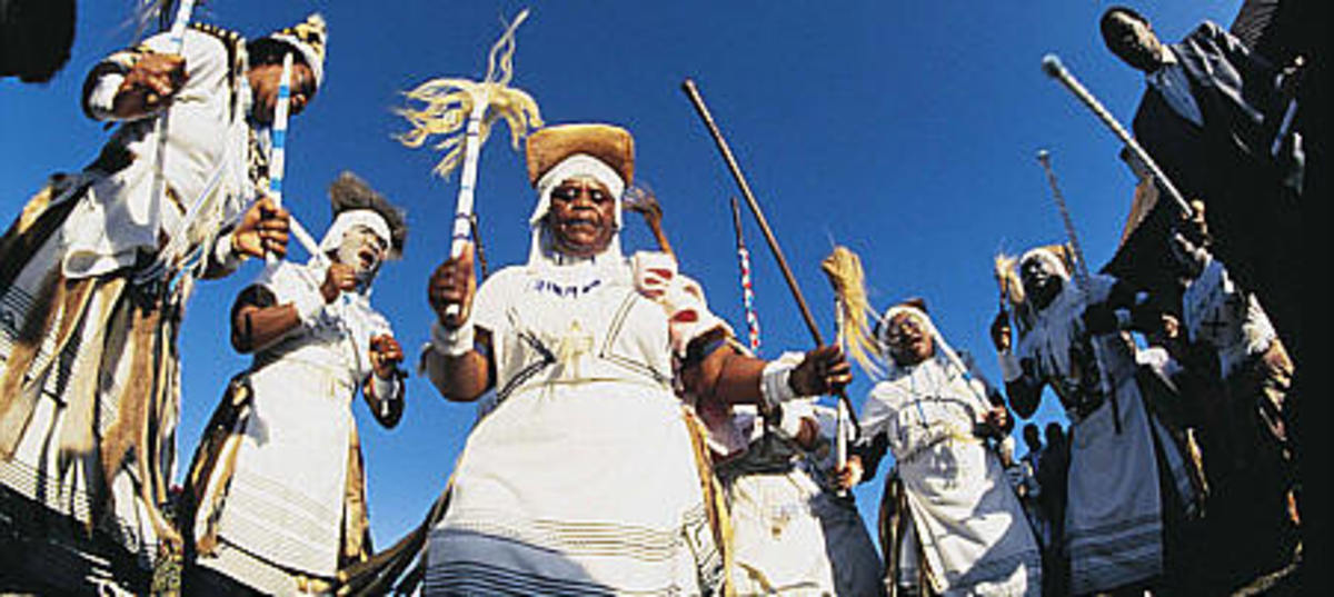 A groups of Xhosa diviners dancing to their ancestral music in their traditional garb