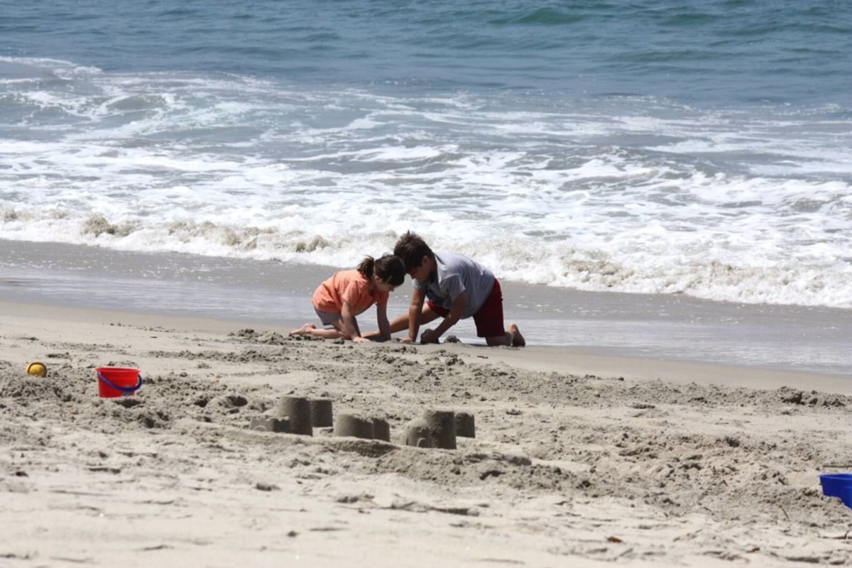 Our kids playing on the beach at the Pacific Ocean.