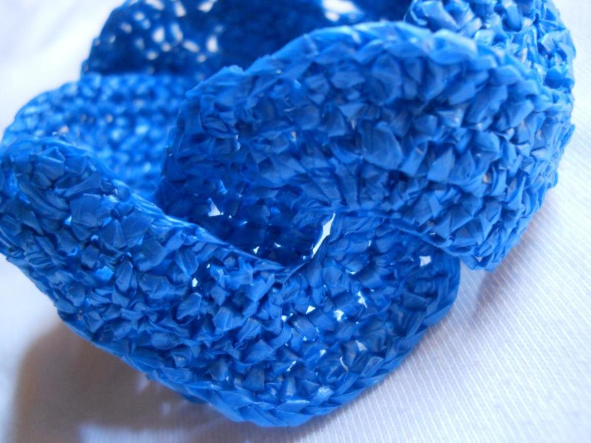 Materials: 1/4-in single-strand plarn from thin blue plastic bag, and #7 steel hook (the one used for crochet thread)