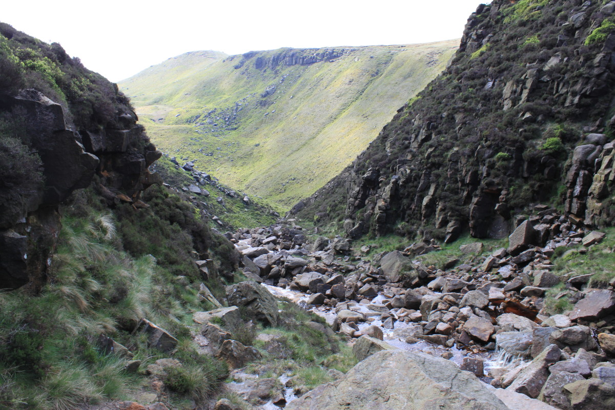 Looking back down Grinds Brook which shows the rugged scramble just achieved and Kinder Ridge in the distance