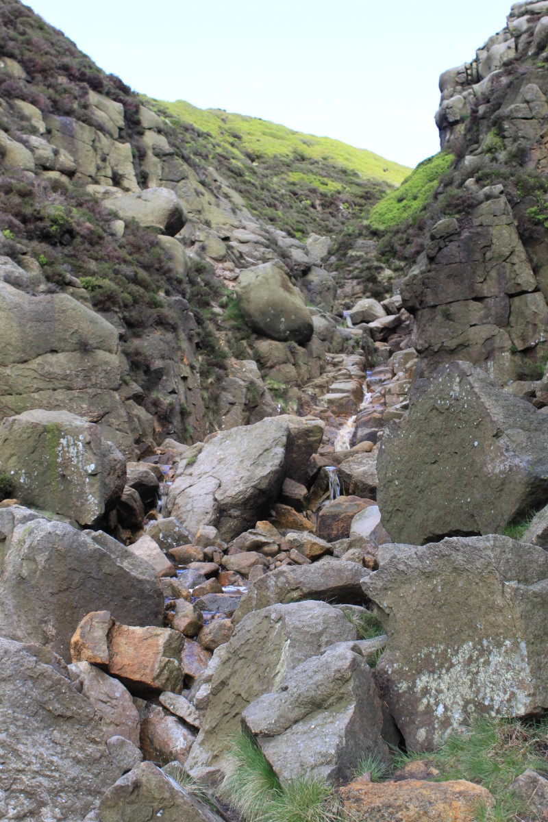 Even More of a scramble higher up the trail as you climb up between the haystacks towards Kinder Ridge