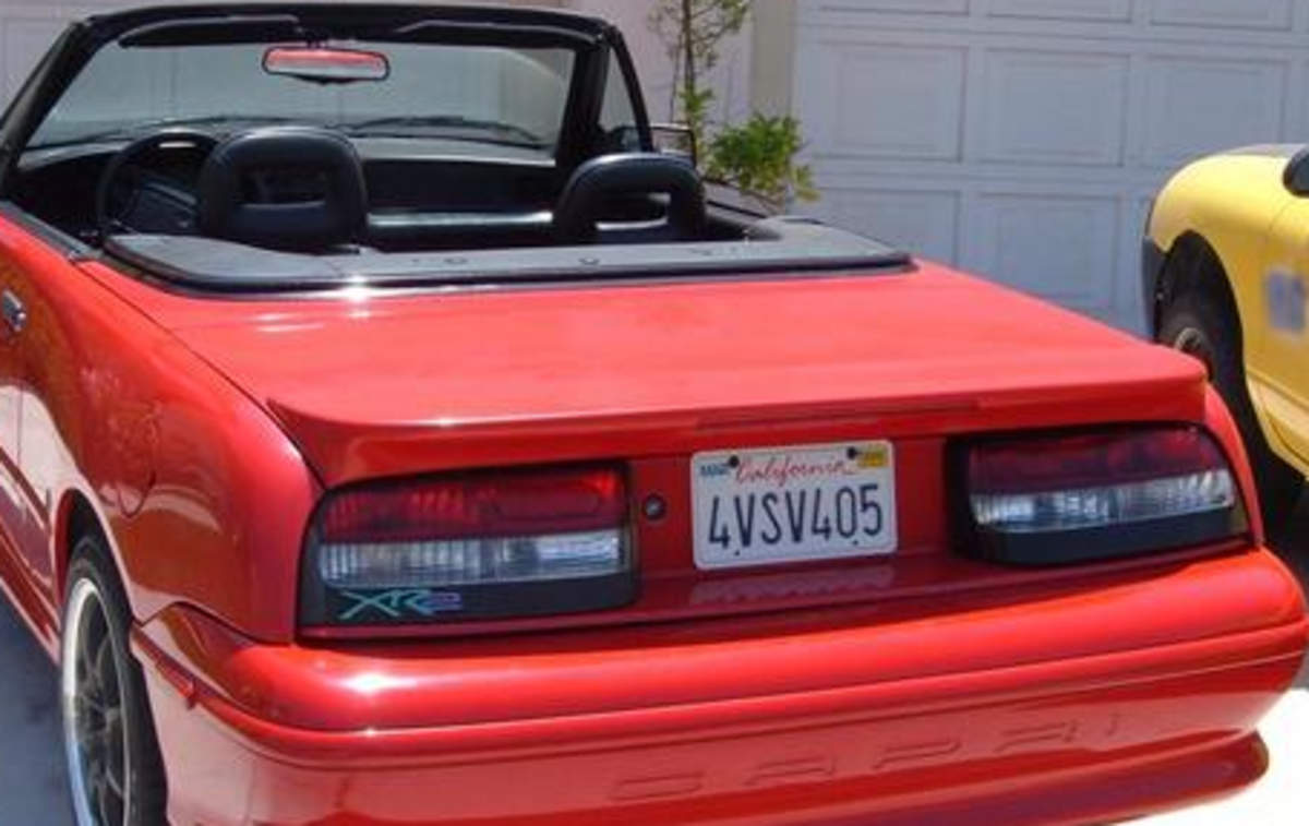 Rear of a 94 with spoiler and taillights . The valance is seen under both of them above the bumper
