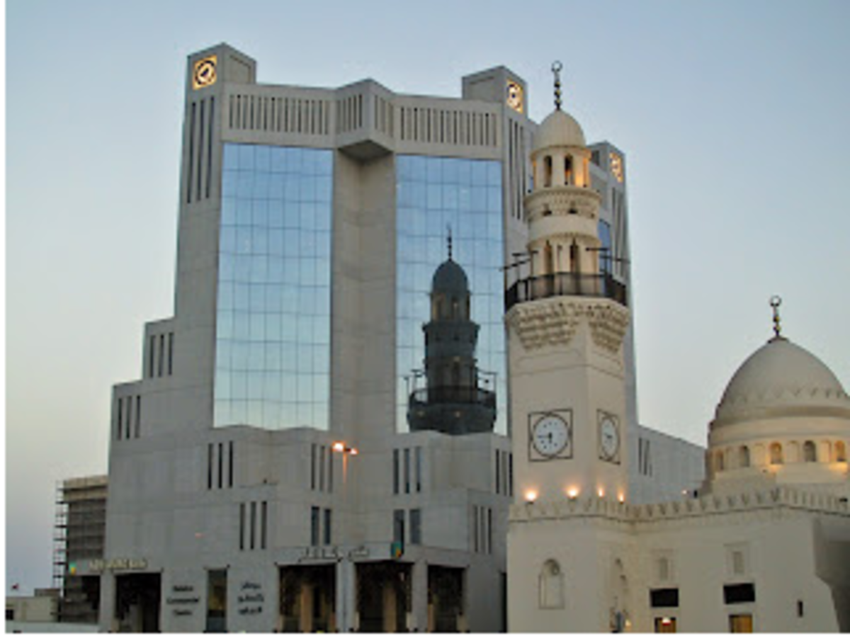 Bahrain Telecommunications Building (Batelco) - shows a magnificent reflection of the old mosque' minaret against its modern glass architecture