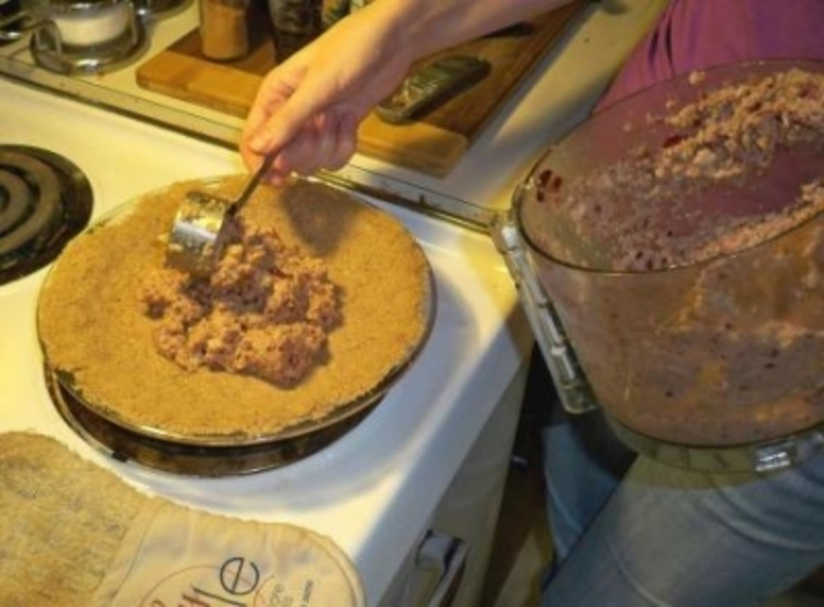filling the pie crust with charoset