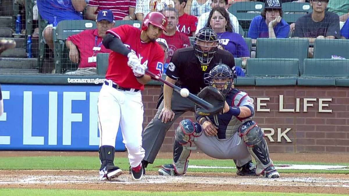 His eyes are on the ball, watching his bat hit it. The swing looks like he's going to hit the thing into the gap in the outfield.