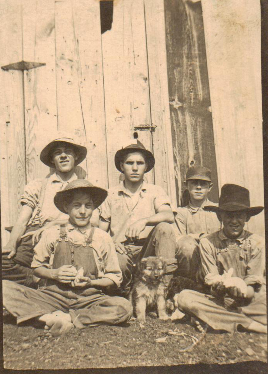 Clarence McGhee is the shorter boy in back.
