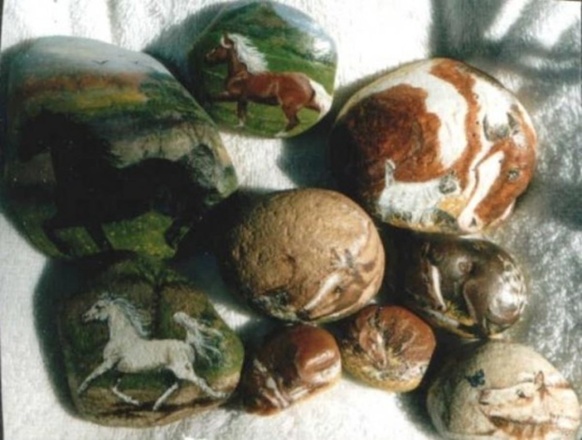 Horses and a variety of animals on rocks