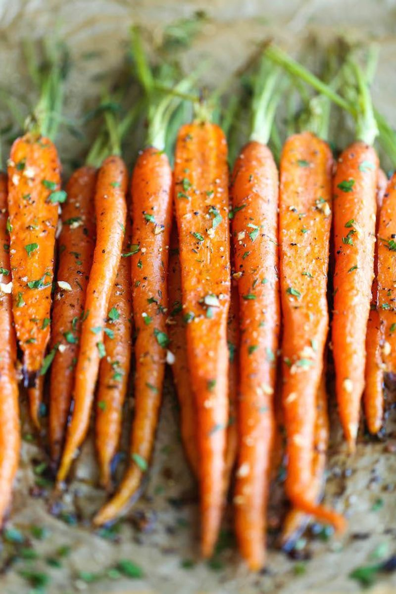 Garlic roasted carrots take no time to prepare. They are pretty and delicious on any table.