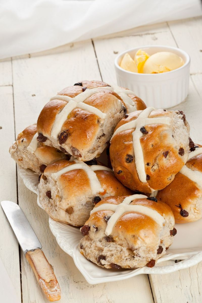Hot cross buns made with raisins, candied citrus peel, and crosses of sweet white icing, have long delighted families on Easter morning, and if any are left over, they end up on the dinner table.