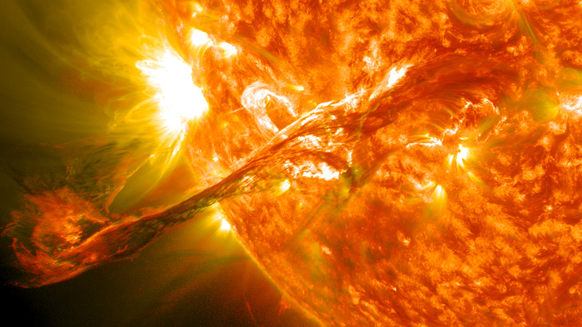 On August 31, 2012, a long eruption of solar material that had been hovering in the Sun's atmosphere, the corona, pushed out into space . The flare caused auroras to be seen around the world in the Earth's sky after darkness.
