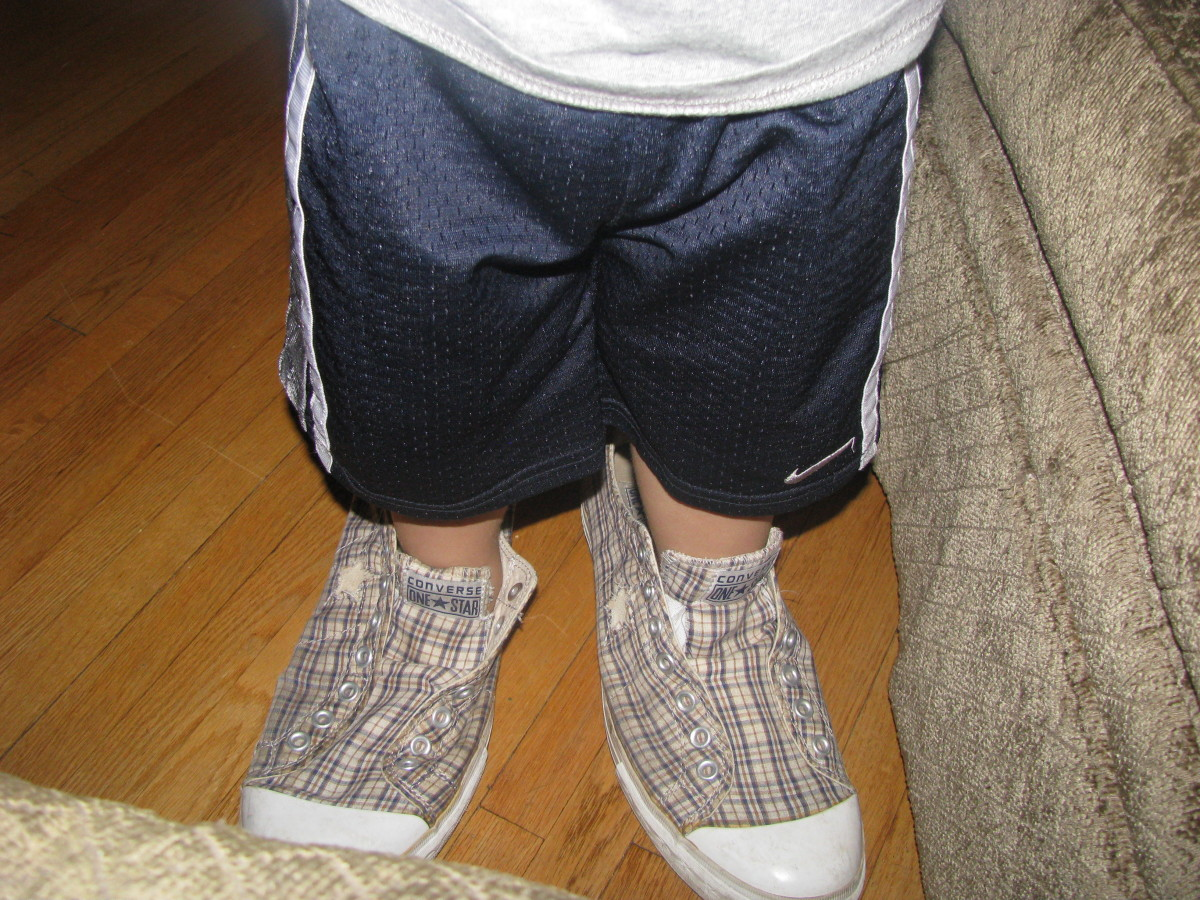Dad's shoes, and wrong feet. At least he tried!