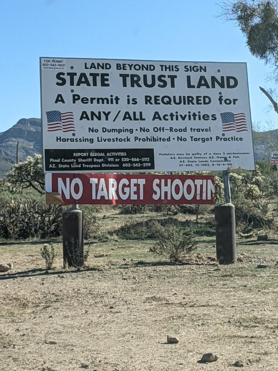 Large billboard sign announcing start of State Trust Land
