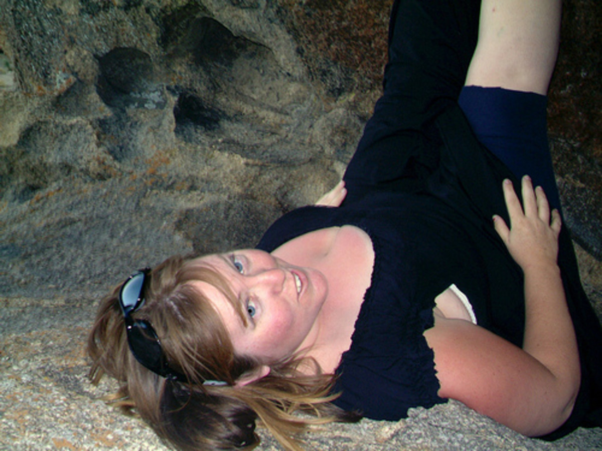Pretending to hold up a massive boulder with my legs in the Alabama Hills, California, 2006
