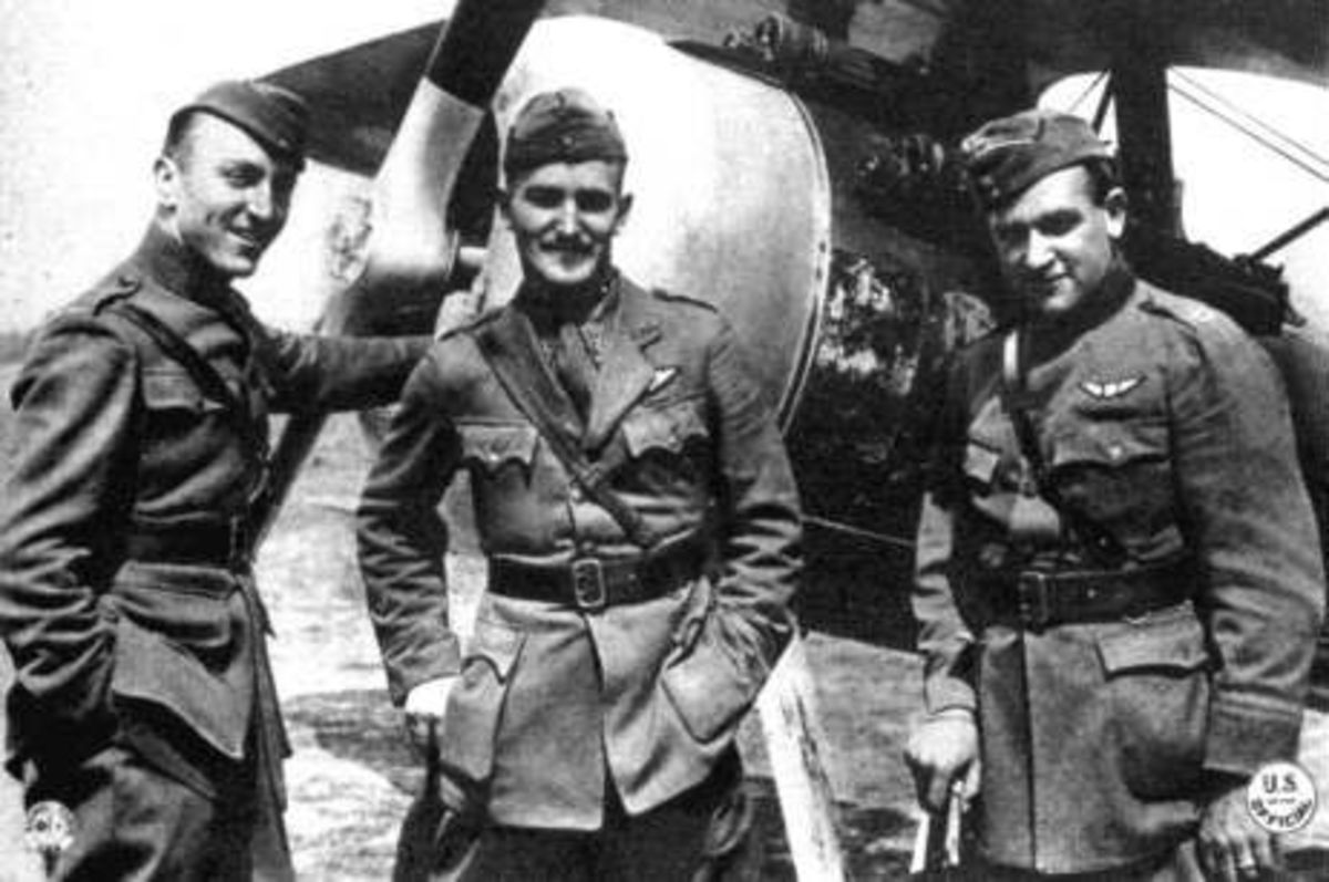 Eddie Rickenbacker, Douglas Campbell, and Kenneth Marr of the 94th Aero Squadron pose next to a Nieuport 28 fighter, 1918.