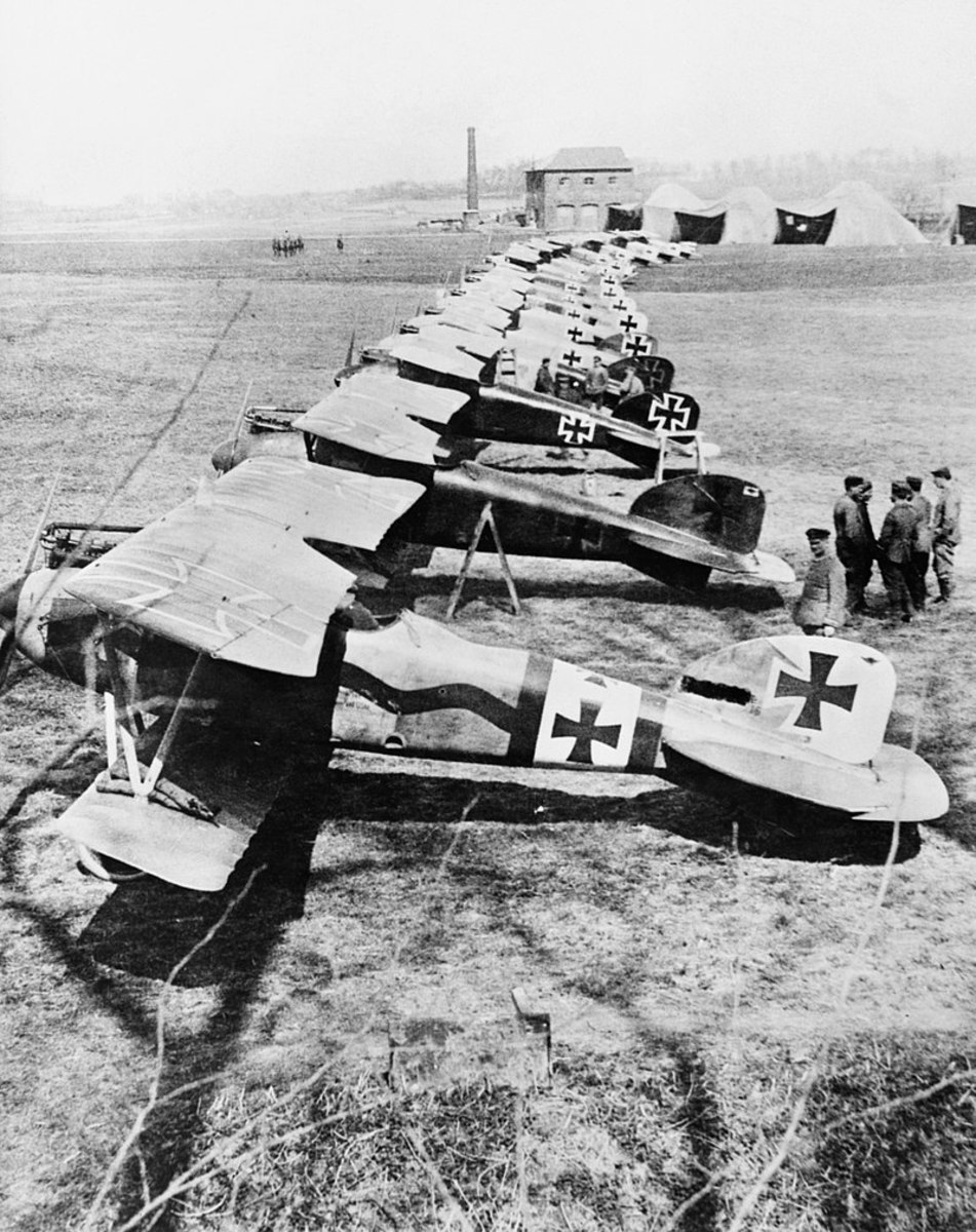 "Albatros D.III fighters of Jasta 11 at Douai, France. The second closest aircraft was one of several flown by Manfred von Richthofen known as the ""Red Baron"" leading Ace of the First World War with eighty combat victories."