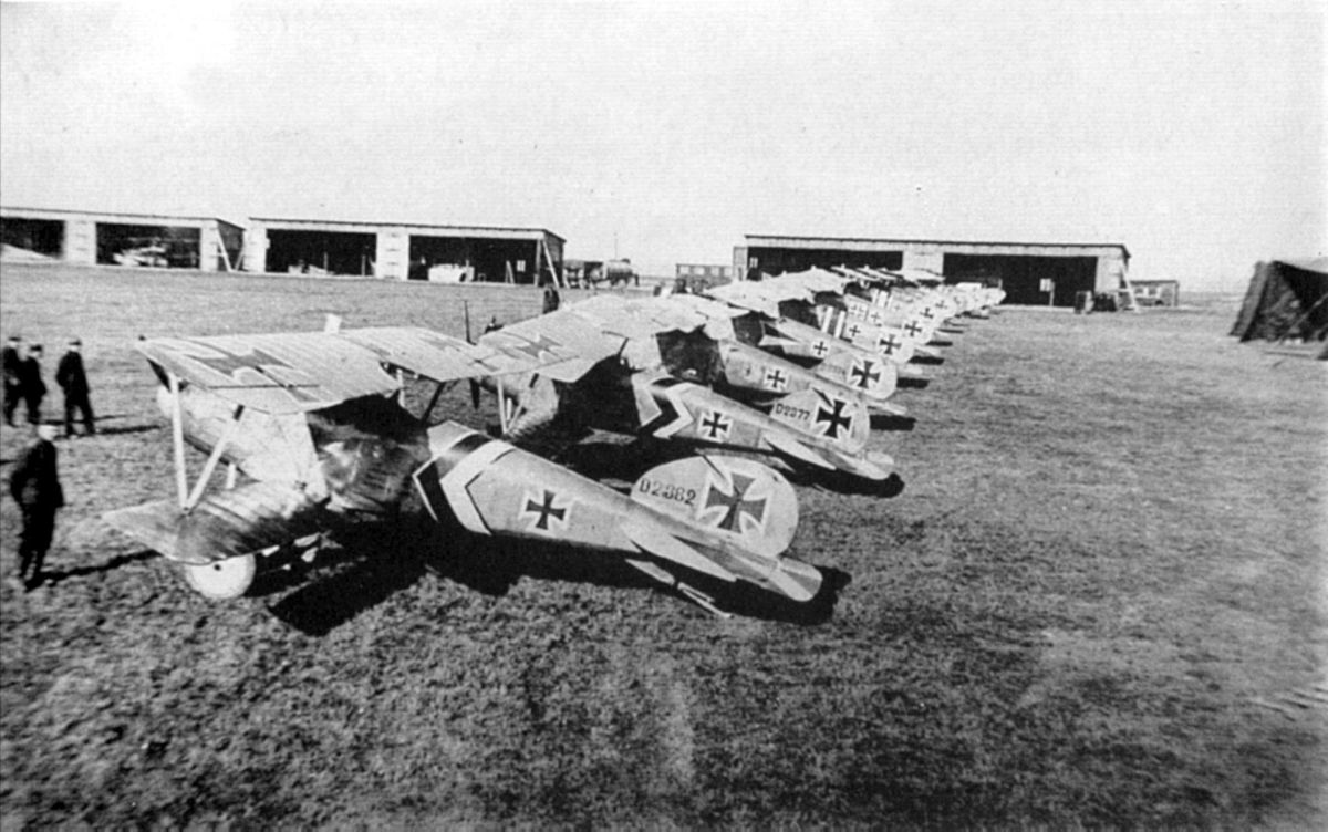A lineup of Albatros D.III fighters of Jagdstaffel 50 - mid to late 1917. The subdued staffel scheme of black and white stripes and chevrons can be seen on the fuselage of most German figher planes, which are otherwise in factory finish.