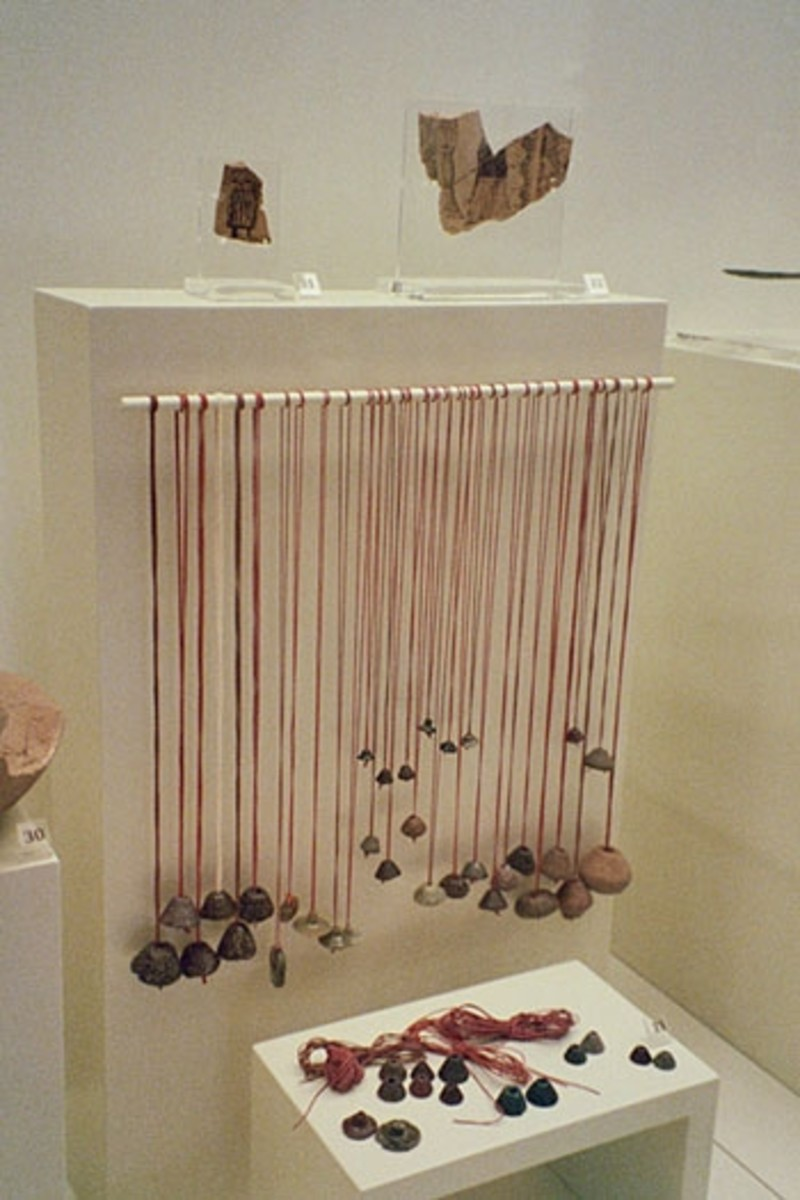 Ancient loom-weights hung from modern thread so you can see how they worked.