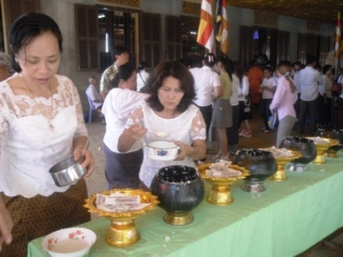 Laddling the rice on Pchum Ben