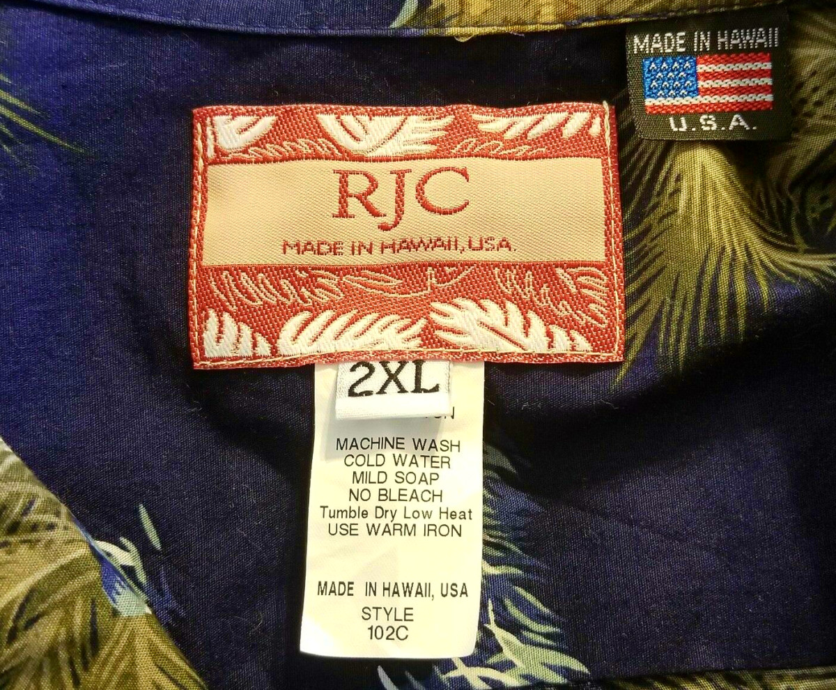 The label of the RJC 100% Cotton Hawaiian Short Sleeve Button Front Shirt Made in USA Men's 2XL