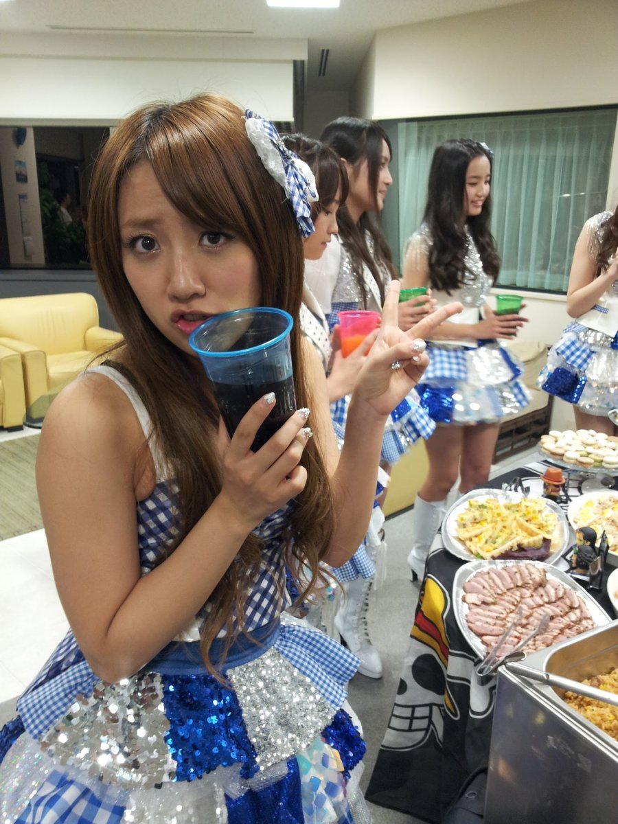 Minami Takahashi (known as Takamina) holding a soft drink in her hand and she looks like she is nervous but she is still so cute!