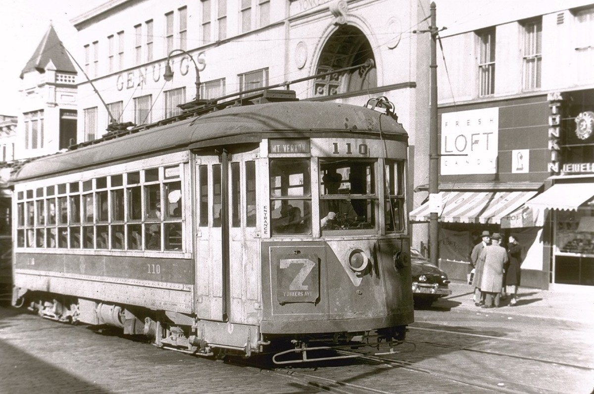 No. 7 trolley winds its way up Main Street heading toward Yonkers Avenue in Yonkers, N.Y. Genungs Department Store can be seen in background. Trolleys were replaced in Yonkers with buses in November 1952.