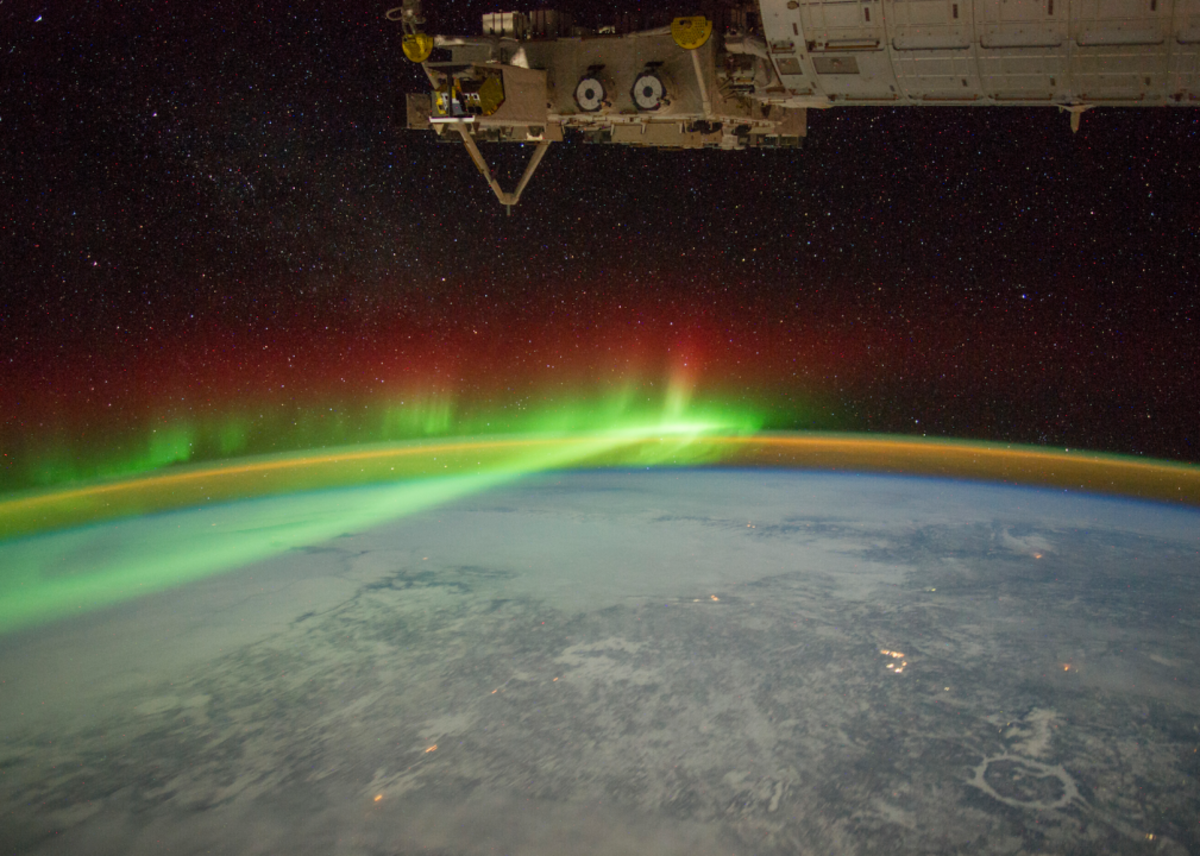 The aurora borealis in this picture from February 2012. This image also shows airglow along the horizon. The Manicouagan Crater, seen in the lower right, was created by an asteroid impact approximately 214 million years ago