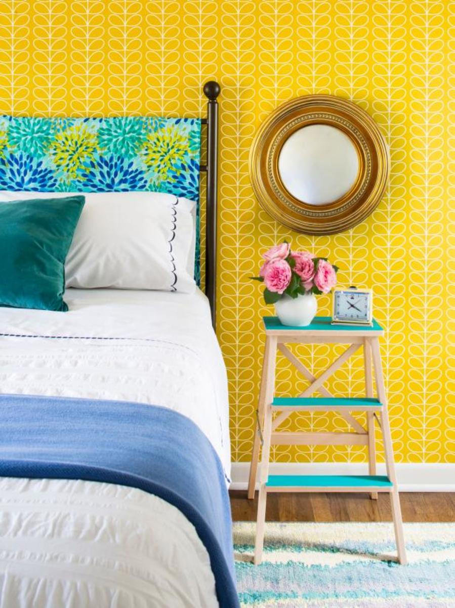 The little wood ladder has used the side table bed. The metal headboard  and the yellow beautiful wall.