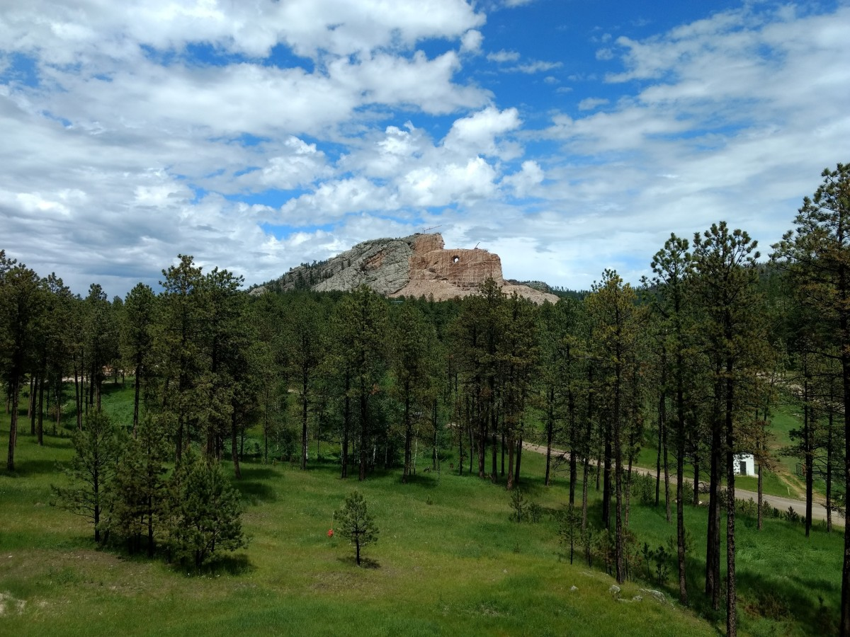 Photo of the Crazy Horse Memorial taken from the visitor's center parking lot.