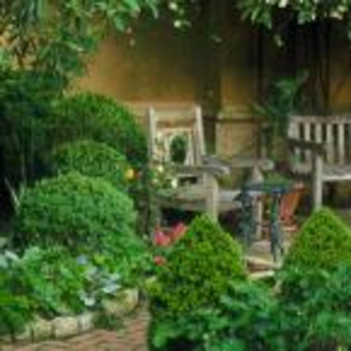 Seating should compliment the garden and snuggle into the plants