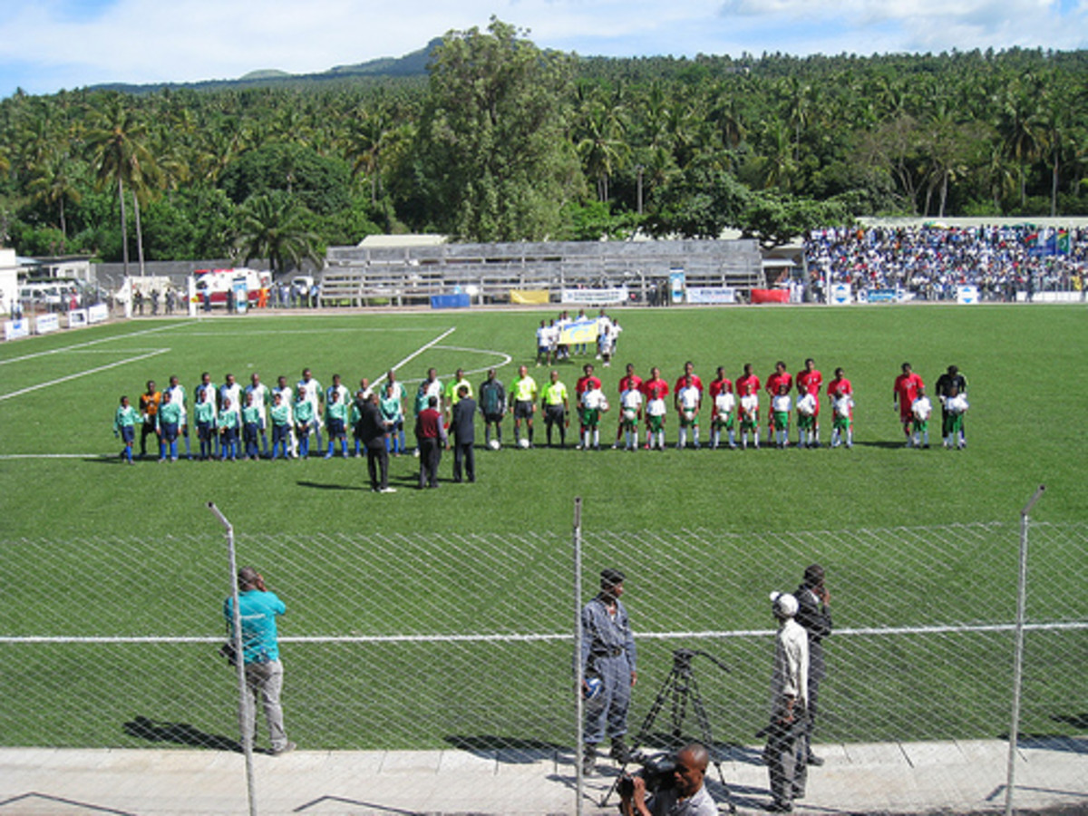 Players from Comoros (white) and Madagascar (red) line up ahead of a matchup in 2007 at Stade Said Mohamed Cheikh in Mitasouli, Comoros. This 2010 AFCON/WC qualifier was the first game Comoros hosted since first playing internationally in 1979.