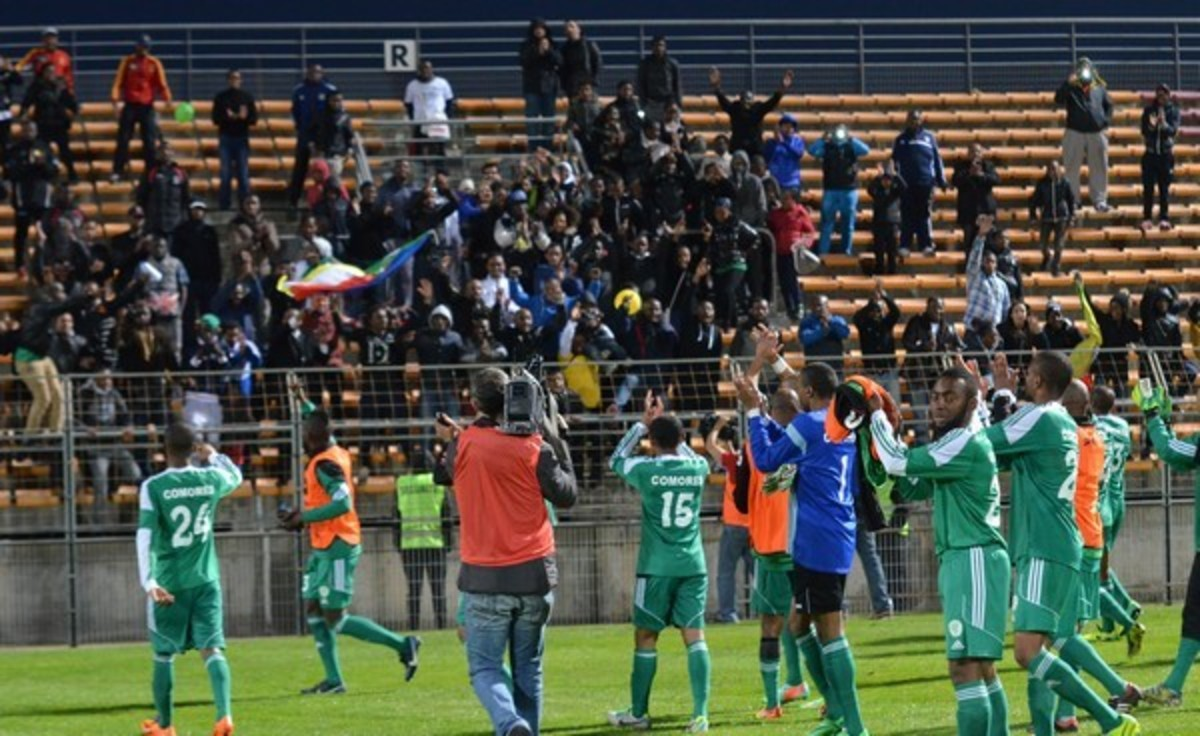 Comoran players celebrate with fans inside Stade Francis Turcan following a friendly match against Burkina Faso in 2014. The match finished 1-1 as Comoros played its first match in 15 months.