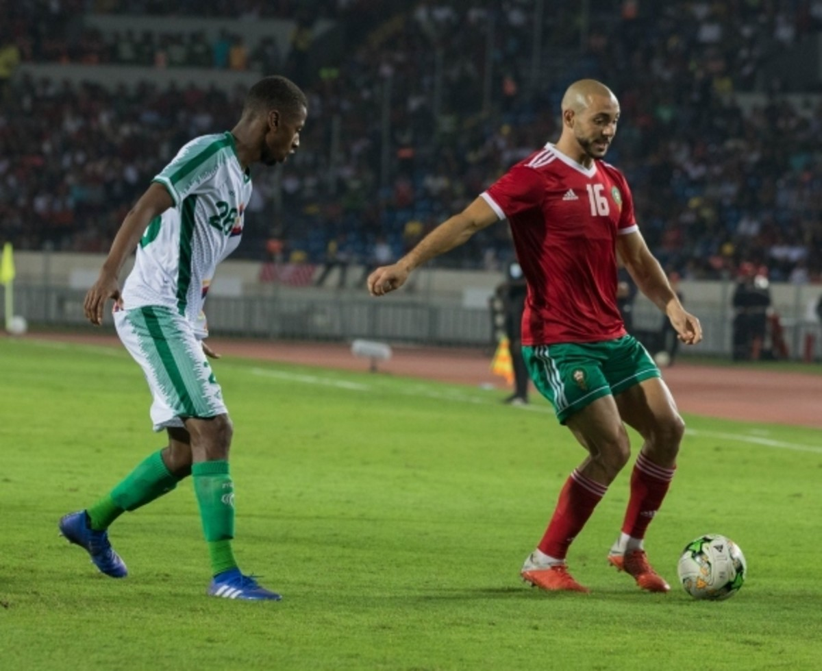 Comoros' Kassim M'Dahoma (L) and Morocco's Nordin Amrabat battle for the ball during a 2019 AFCON qualifier at Stade Casablanca V on Oct. 3, 2018. Comoros lost this qualifier on a late goal, ultimately denting its qualification hopes.