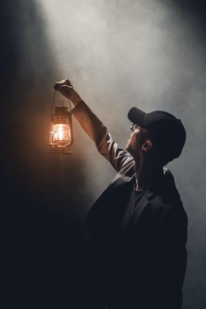 Stage Spotlight meets man with lantern